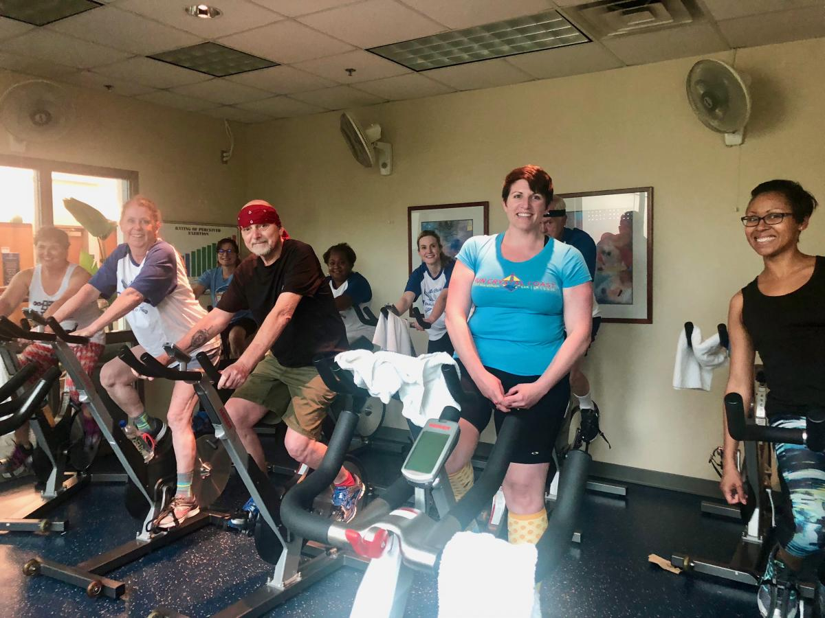 As a way of showing gratitude to his care team at Duke, Rick Leavitt (center, front row) leads a private cycle class at the studio he teaches classes.