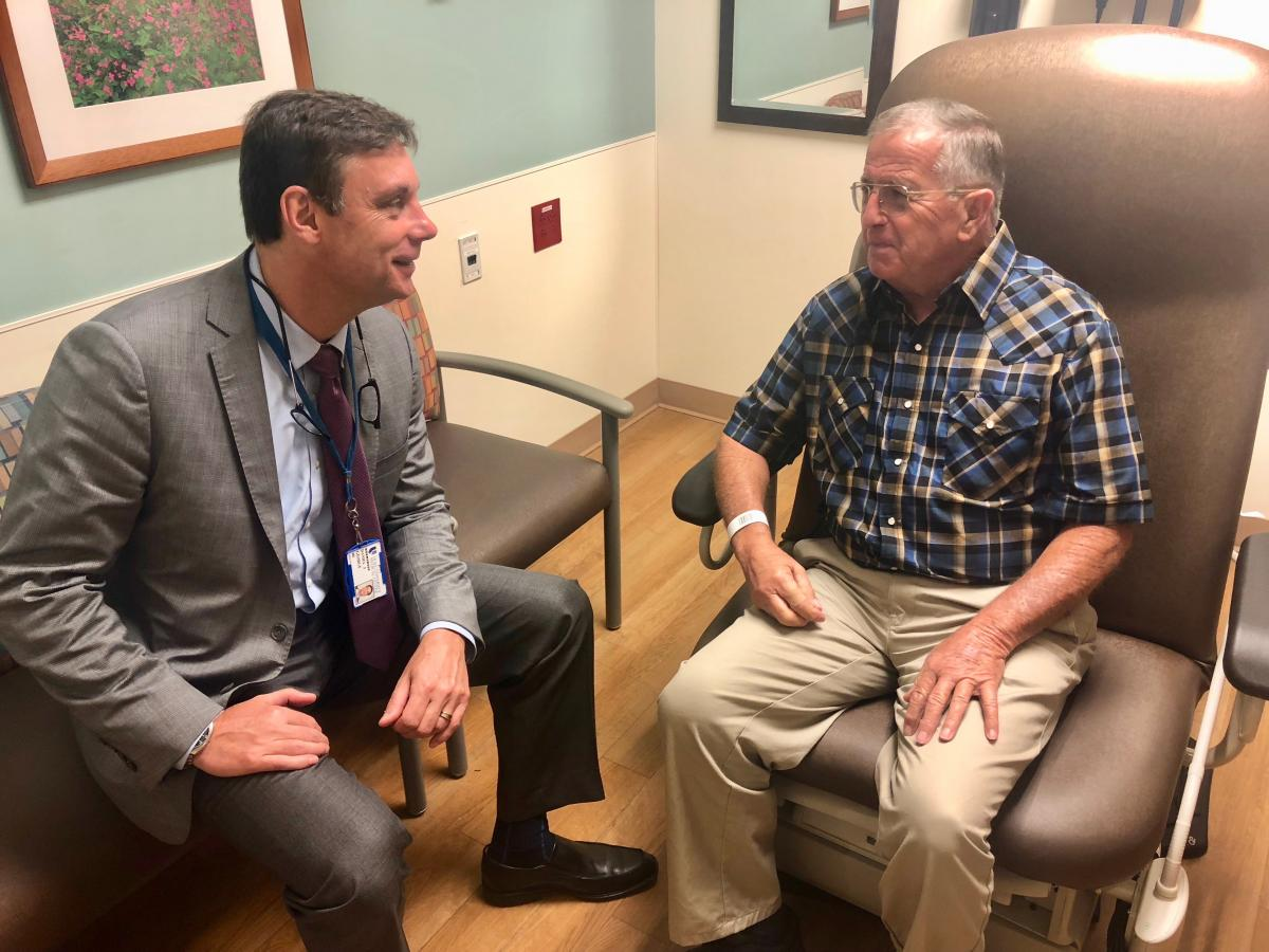 Daniel George, MD, and Otto Griffin discuss his treatment plan during a clinic visit.