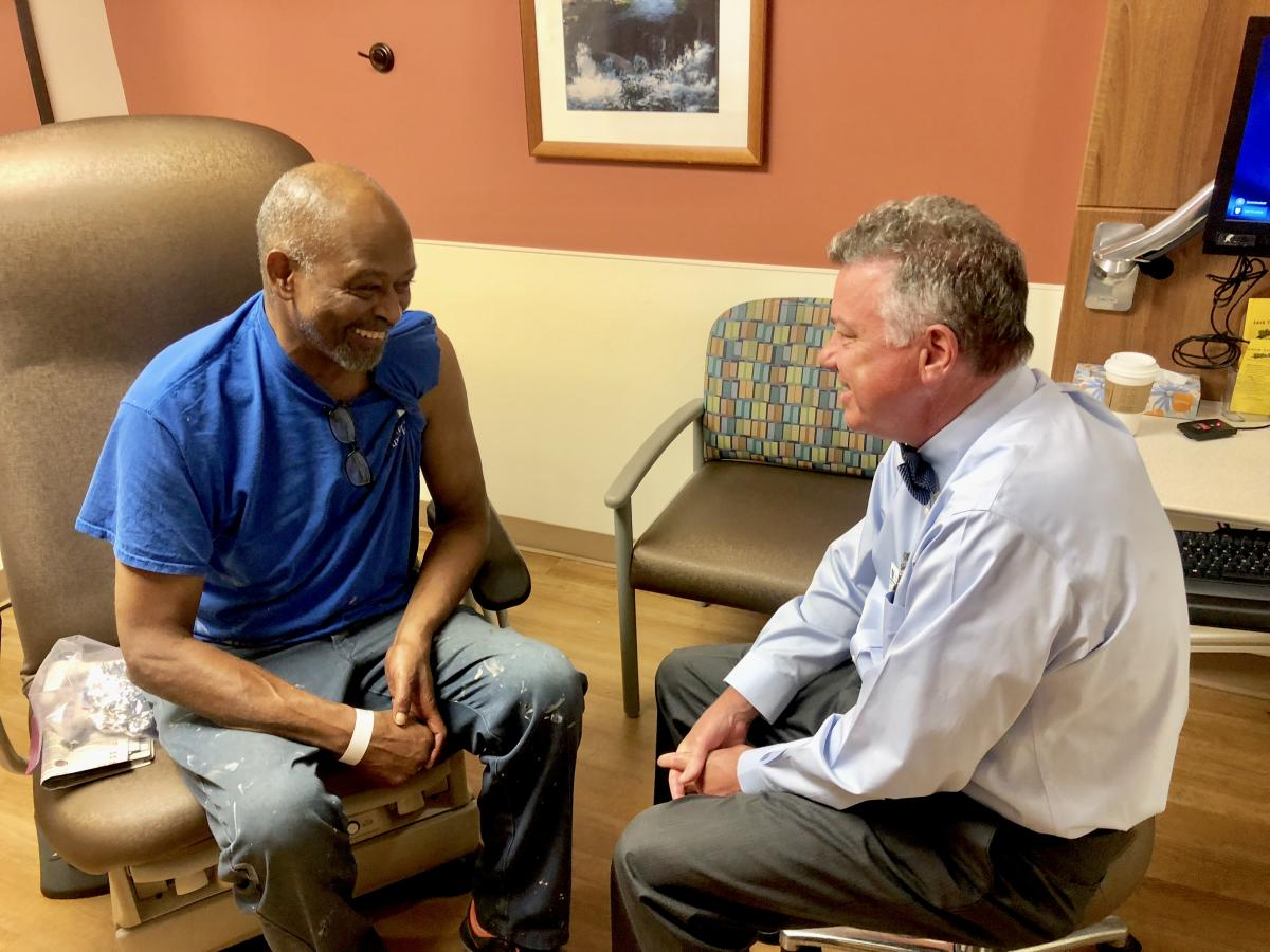 Robert Dixon visits with his radiation oncologist, W. Robert Lee.