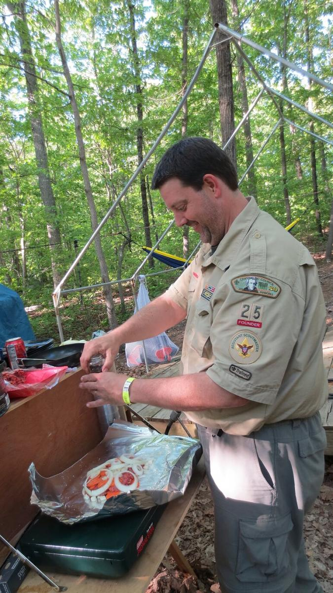 Roger grilling during an Eagle Scout camping trip